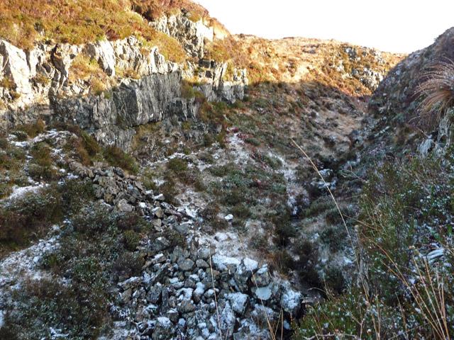 Stone wall across a gorge on the Tarskavaig Burn