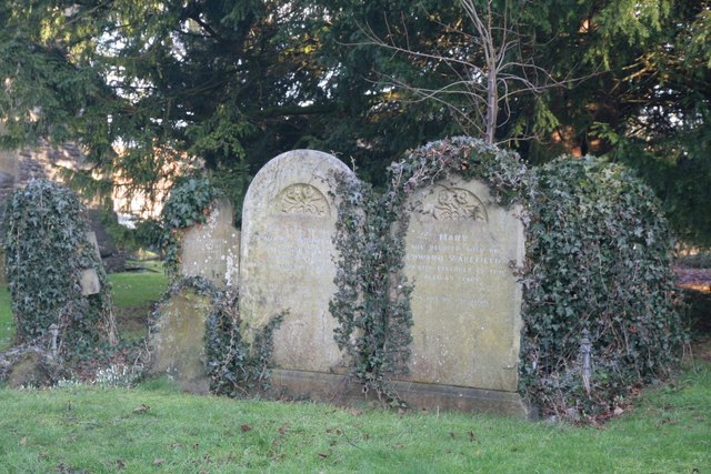 Headstones by the yew tree