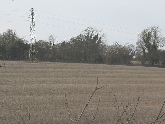 Electricity tower in a field