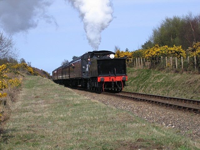 Train approaching Kelling Heath crossing