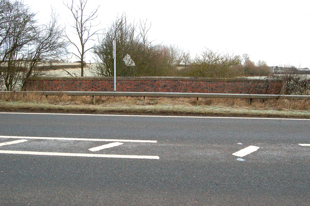 Looking east across the A45 at Wolscott Bridge over the Rains Brook