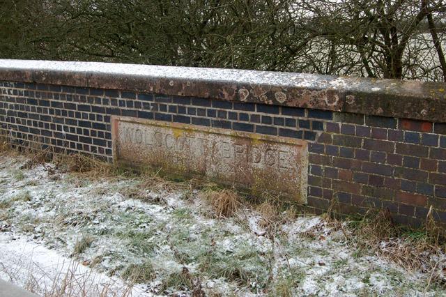 Cast concrete name plaque, Wolscott Bridge, Dunchurch