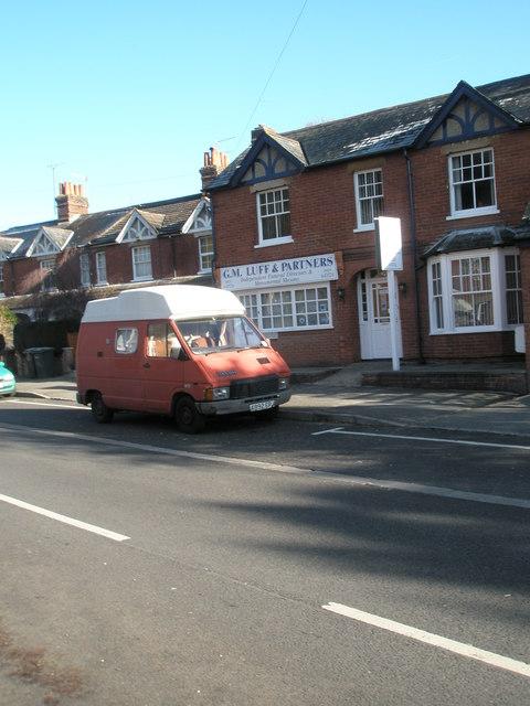 Splendid old camper van outside G.M. Luff & Partners in Lion Lane