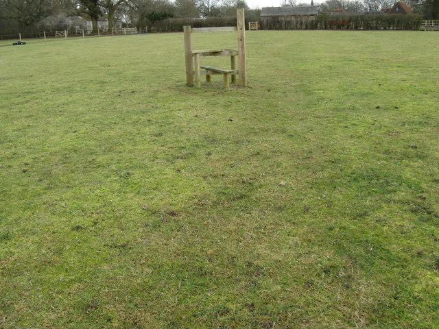 Stile in open plan field at Oldhouse Farm