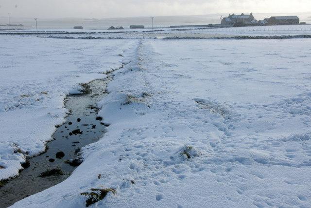 Ditch in the snow below Halligarth, Baltasound