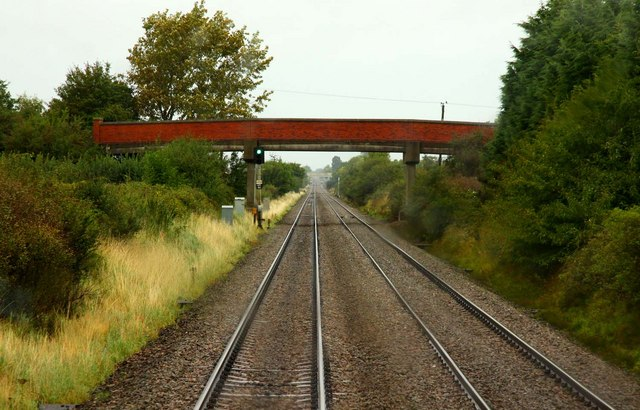 The road to Claydon crosses the railway