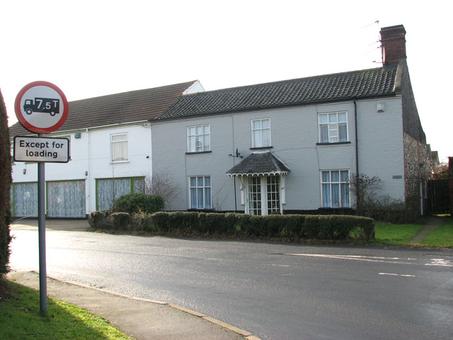 Cottages by the junction of Burnthouse Lane and School Road
