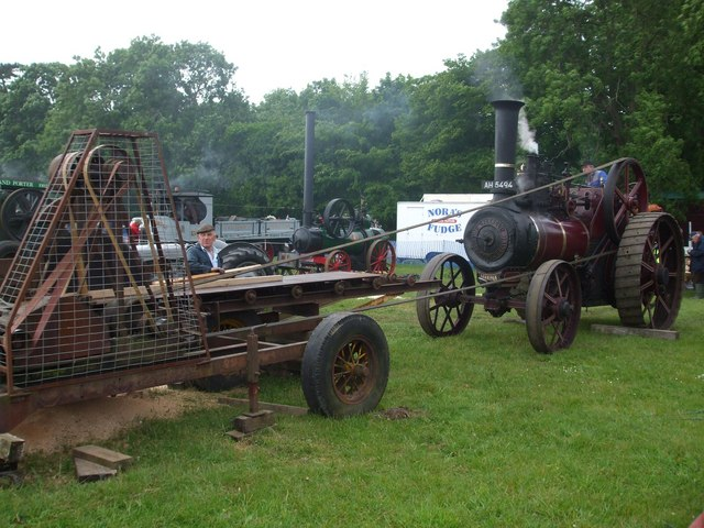 Burrell traction engine sawing planks