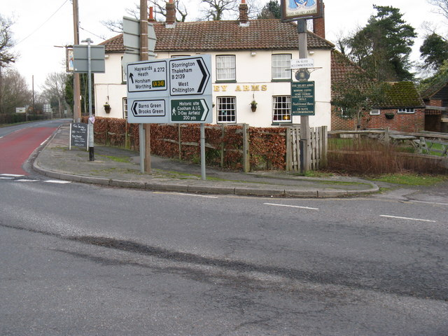Various road signs hiding the Selsey Arms