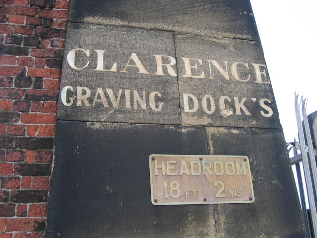 Inscription and sign on Clarence Graving Docks gatepost