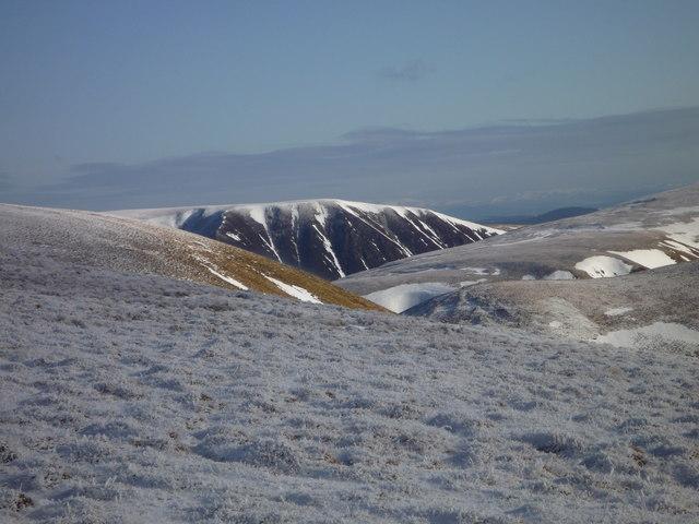 Saddle Craigs across a frosty Hart Fell