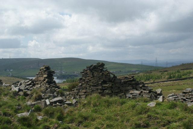 A broken wall by the Pennine Bridleway