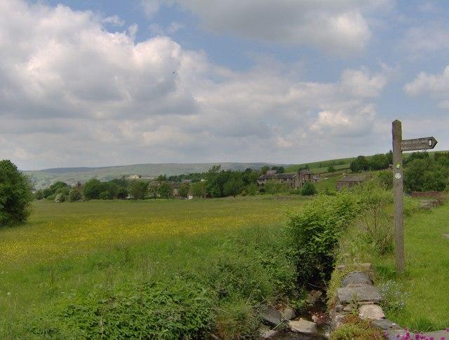 A ditch and a signpost at Rakewood