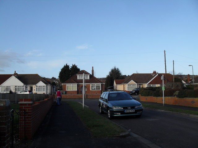 Approaching the junction of The Downsway and The Crossway