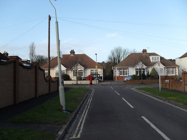 Looking from The Fairway towards a postbox in The Crossway