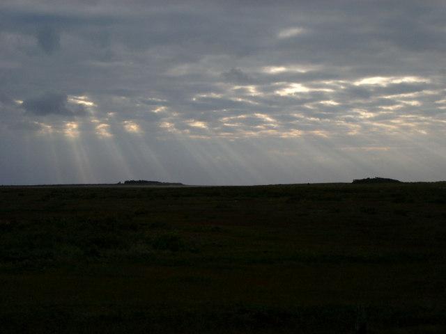 Crepuscular rays over Titchwell salt marsh