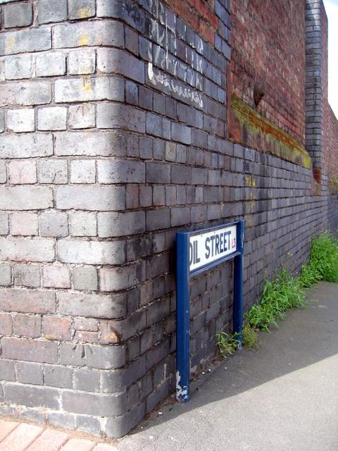 Bench mark on the corner of Oil Street