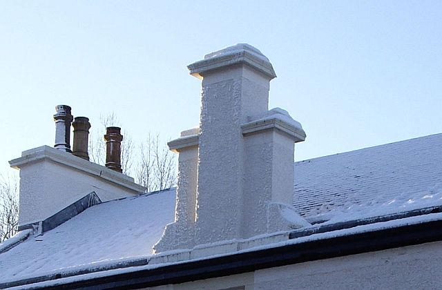 Shouldered wall head chimney
