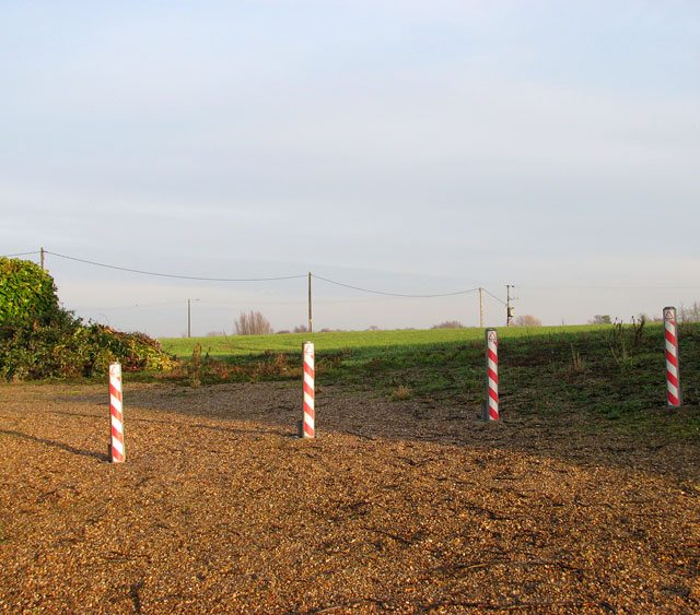 Bollards and poles east of Acle Road