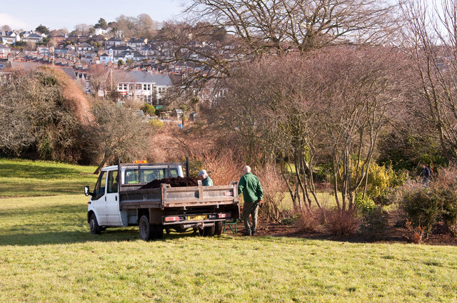 Mulching the shrub beds, Central Park - Plymouth