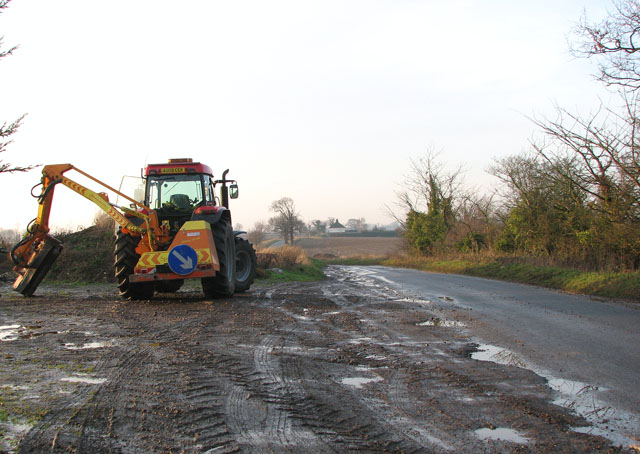Tractor parked beside Ash Tree Road