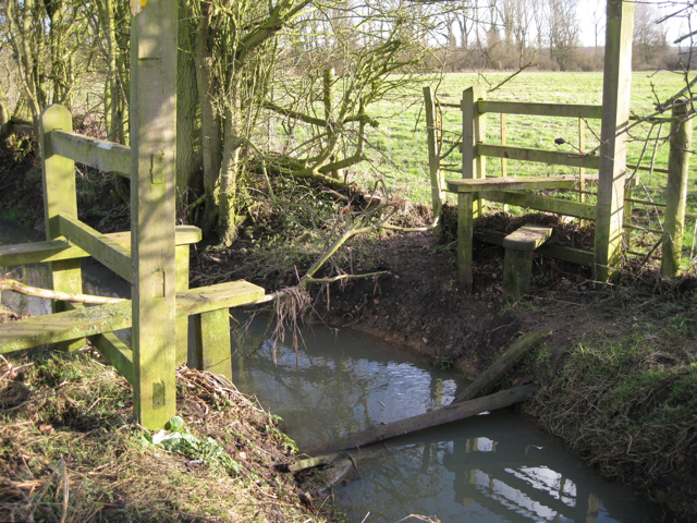 A ditch flanked by two stiles