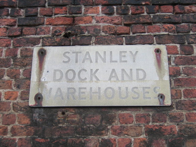 Old sign on the Stanley Warehouse wall