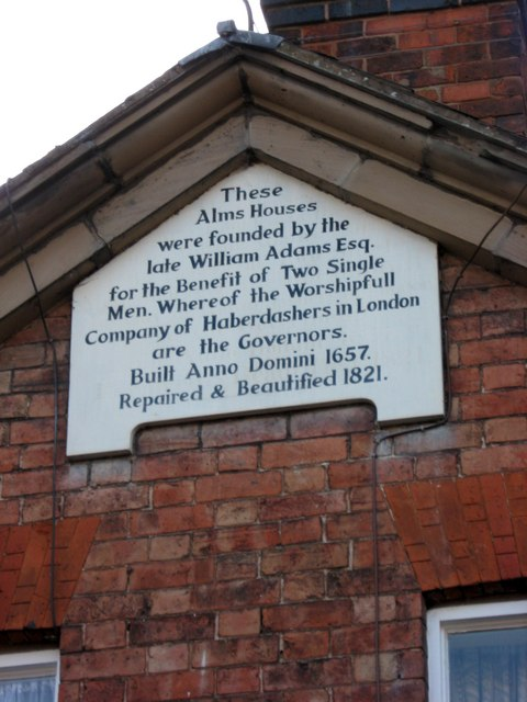 Commemorative stone on almshouses, High Street