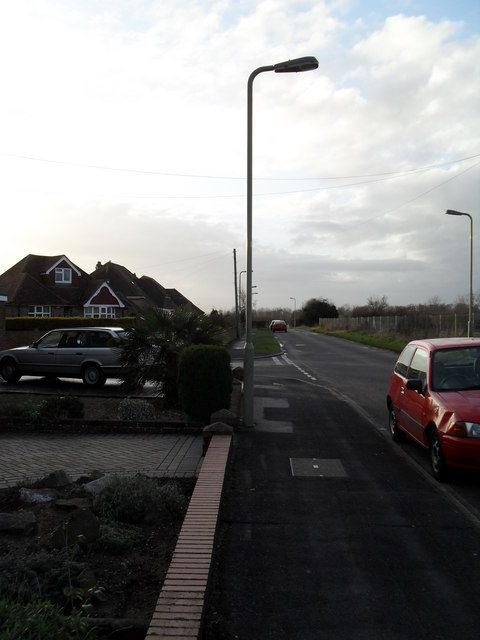 Approaching the junction of  Cranleigh Road and Orchard Grove