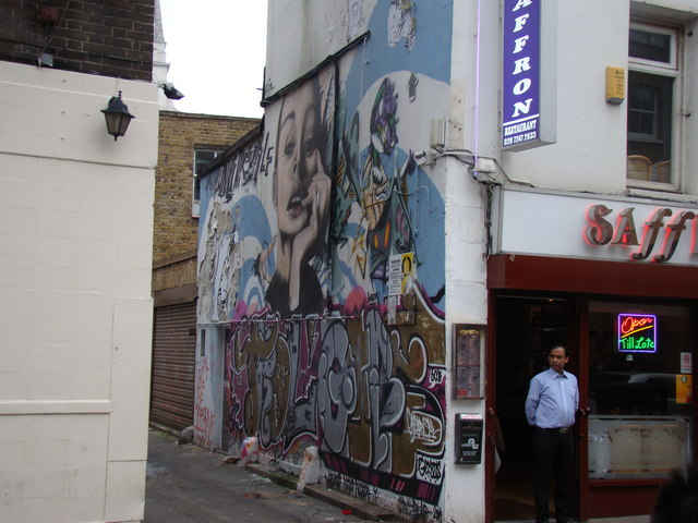 Graffiti and murals on the side of Saffron Indian Takeaway