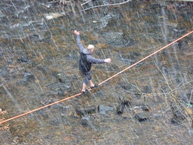 Tightrope walker crossing the River Spodden