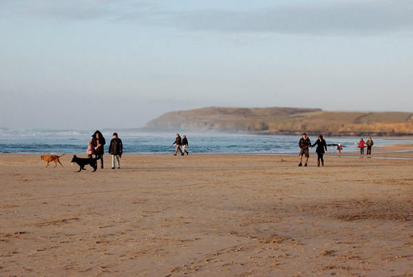 Group on Gwithian beach in evening light