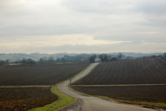 Road across a ploughed landscape south of Flecknoe