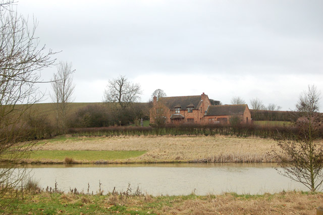 New house and pond south of Flecknoe
