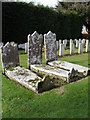 SU9006 : Gravestones ancient and modern at  St Andrew, Tangmere by Basher Eyre