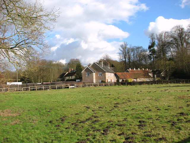 View across paddock to Rushford Hall and Cottages