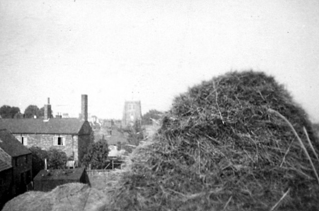 1952 view of Rothwell Church and farmhouse from the farmyard