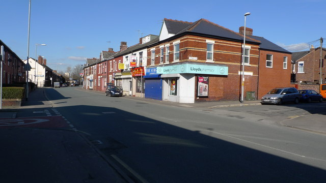 A row of shops and houses on Reddish Lane