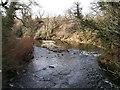 NS7063 : North Calder Water at old mill by Robert Murray