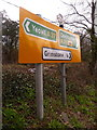 SY6394 : Grimstone: signs facing the A356 by Chris Downer
