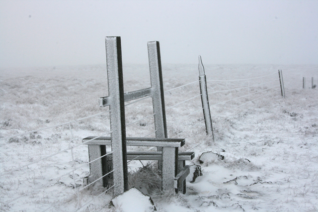 Stile by Cold Fell summit