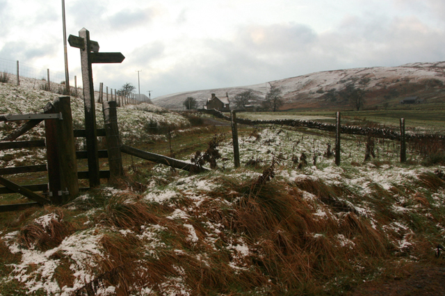 Signpost to Stagsike with Tortie Hill beyond