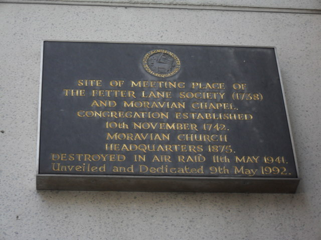 Black plaque № 3954 - Site of meeting place of the Fetter Lane Society (1758) and Moravian Chapel. Congregation established 10th November 1742.  Moravian Church headquarters 1875.   Destroyed in air raid 11th May 1941.
