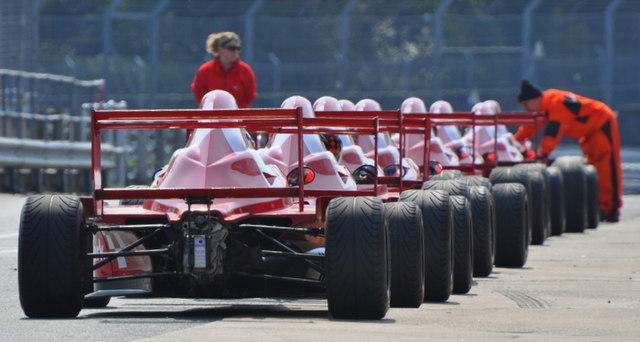 Single seaters waiting to leave the pit lane