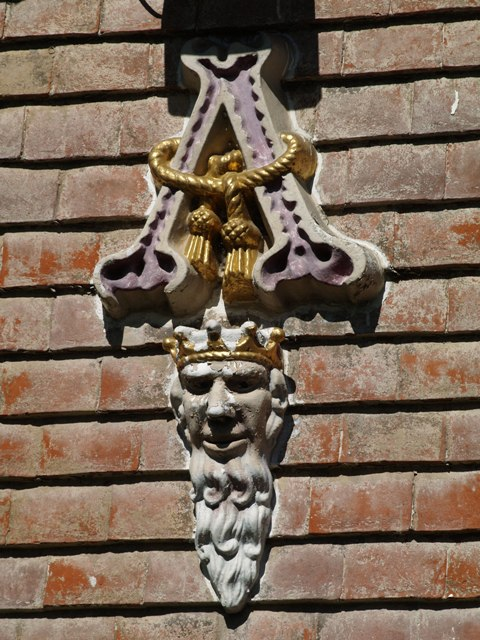 One of four decorative ceramic heads on the facade of the Nevill Arms and Gun at Eridge Green