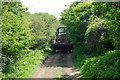 TQ3804 : Tractor on the bridleway by Robin Webster