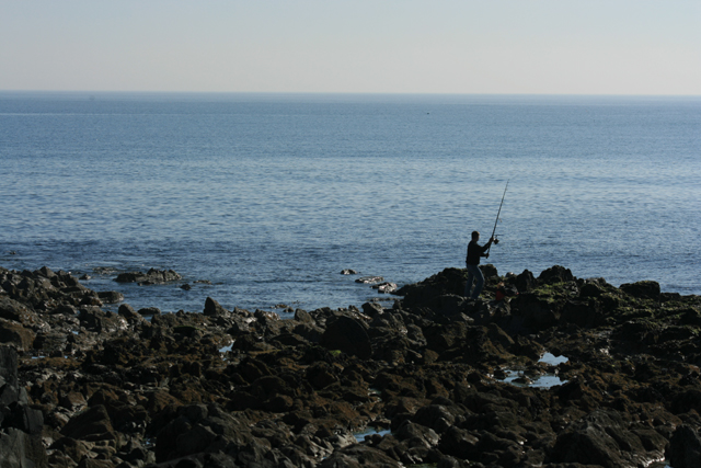 Lone angler at the end of Forlorn Point, Co. Wexford