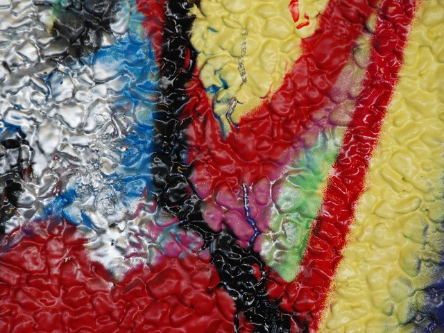 graffiti detail: bright slashes of red blue black yellow silver
