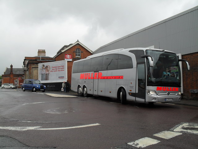 Large coach outside Salisbury Station