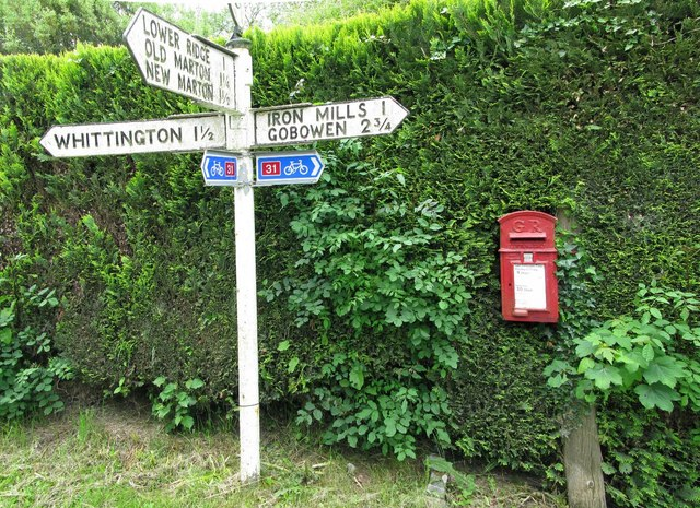 Postbox and Road sign in Hindford